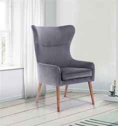 Grey Velvet Armchair with tapered legs. Stylish and modern seating for any home. Stylish Chairs, Velvet Armchair, Living Room Seating, Grey Chair, Occasional Chairs, Wingback Chair, Accent Pieces, Living Spaces, Accent Chairs