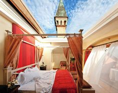 An open-air hotel in Franciacorta, Lombardy, Italy! This is the Cabriolet Suite, where you can press a button and the roof above the bed opens to the heavens. Wow!