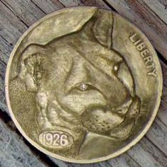 """""""Miss Kitty"""" Hobo Nickel carved by Dick Sheehan - photo from hobonickels"""