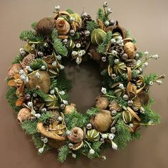 Luxury handmade Christmas wreath made from natural pine cones, pine leaves, citrus and spices