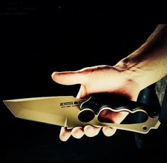 Tops new knife with Slysteel 'Shark Tooth Tactical'