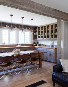 A dining table in an open kitchen.