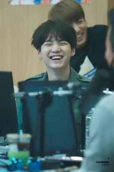 Suga's smile is sweet and little Kookie in the back :)