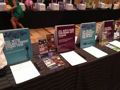I like the look of these vs. boring white with bold titles... Silent Auction display