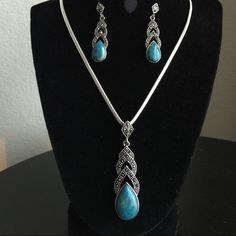 Statement Pendant Beautiful blue natural stones are set in a silver setting with black pave cz's to provide an elegant look. 18-24 inches with adjustable close sure. Jewelry Necklaces