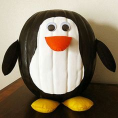 Cute Halloween pumpkin ideas - must remember this one!  My daughter LOVES penguins!