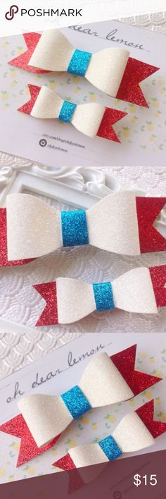 "Red White & Blue Glitter Hair Bows This glitter hair bow set would be an adorable ""mommy and me"" or ""big sister little sister"" set! Colors are red white and blue. Glitter is sealed with strong adhesive, so you don't have to worry about any loose glitter coming off. Large bow measures 3 1/2"" and the small bow measures 2 1/2"". Alligator clips are securely attached to the backs and are perfect for all hair types. This listing includes BOTH bows! Handmade by me & brand new. Tags: 4th of July…"