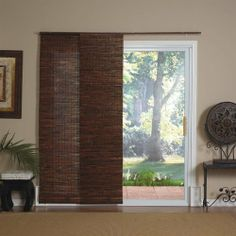 Panel Track Bamboo Blind in Java Mahogany by Radiance. $126.86. Wand control. Made from Bamboo. Light filtering. Energy efficient. Panels neatly stacked. 0224112 Features: -Blind.-Perfect for large windows, patio doors, or as a room divider.-Wand control; panels stack neatly when not in use.-Light filtering and energy efficient. Includes: -Mounts easily; four panels and all hardware included. Color/Finish: -Java mahogany color.. Save 34%!