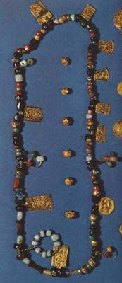 """Hon Necklace"" Viking-Age necklace of beads and gold pieces was found in a grave at the town of Hon, Norway (near Oslo,) in 1834. (Image from The Viking, Bertil Almgren et al, Tre Tryckare, Cagner & Co., Gothenburg, Sweden, 1972, p. 213.)"