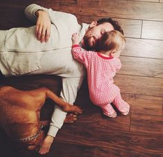 This idea with child's feet near left hand and body going off frame. Wife's head near husband's head laying opposite direction.