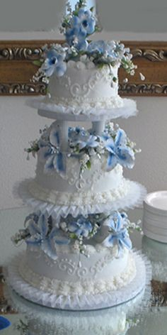 3 tier separated with gumpaste flowers.