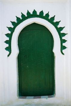 Look closely... while this Moroccan door is a normal shape, the framing around it makes it wonderfully unique.