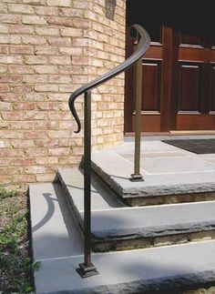 Simple bronze handrail with decorative post shoes. Natural patina finish