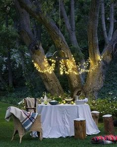 Must have #3: a beautiful backyard/outdoor setting. Keep it simple and natural with light colored linens, comfy pillow and throws, and pretty white lighting and candles.