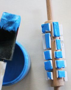 Glue foam pieces to a rolling pin, roll in paint, print paper or fabric or whatever!