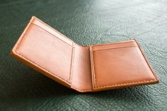 Handmade Wickett & Craig Tan Bridle leather bifold style card wallet. 4 card slots inside with 2 hidden pockets behind. Full leather lining, hand burnished edges, and hand stitched throughout.