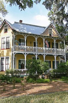 Old Southern Farm House. Love the yellow with the green shutters.