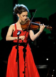Hilary Hahn.  I love two things here... The fabulous violin playing and beautiful dress!