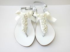 Wedding white Greek leather sandals  White sandals decorated with ivory pearlsPearls sandals Bridal shoes Bridesmaid flatsSummer shoes wedding sandals bridal flats white sandals ivory pearls sandals decorated sandals bridesmaid shoes summer sandals greek sandals ivory bow beach sandals EST leather shoes egst beach wedding pearls sandals 58.00 EUR #goriani