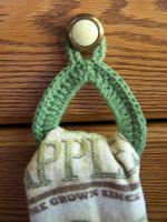 I recently bought a dish towel hanger at the local farmer's market, thinking, finally, I could hang any towel I wanted off the utensil drawe...