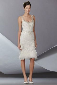 Gatsby Inspired Wedding Gowns 2014 - A short 'n sweet wedding dress creation of feminine feathers and beautiful beading. (Carolina Herrera Fall 2014 Bridal Collection) | Confetti Daydreams ♥  ♥  ♥ LIKE US ON FB: www.facebook.com/confettidaydreams  ♥  ♥  ♥ #Wedding #Gatsby #GatsbyWedding #WeddingDress #1920s