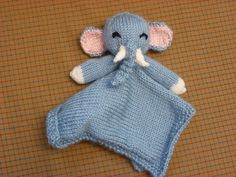 Free knitting pattern for Elephant Lovie. Thora Bey designed this blanket buddy. The body is knit flat and then the head and legs are sewn on at the center. Also known as blanket buddy, lovey, lovie, comfort blanket, blanket toy, blankie, security blanket, woobie, cuddle.