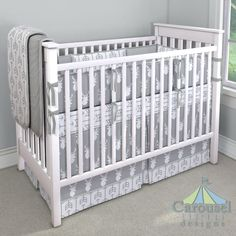 Crib bedding in Solid Silver Gray, Silver Gray and White Deer Head, Silver Gray Arrow, Silver Gray Minky, Solid Cloud Gray. Created using the Nursery Designer® by Carousel Designs where you mix and match from hundreds of fabrics to create your own unique baby bedding. #carouseldesigns