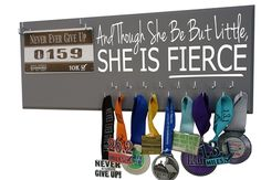Display every little victory with this beautiful medals holder! Painted in a color of choice with the words 'Though she be but little, she is fierce - Shakespeare' across the top, You can select your favorite color and your favorite style.