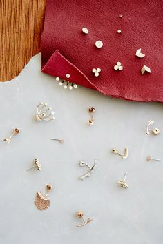 Our current favorite trend: mix and match earring studs and crawlers. Make your earring set your own!