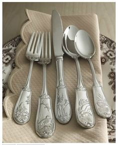 """Woodland"" Flatware - A variety of wildlife motifs add texture to the handles of this distinctive flatware. Handcrafted of 18/10 stainless steel."