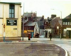 British army bomb disposal specialist approaches a suspect vehicle in Northern Ireland, early '70