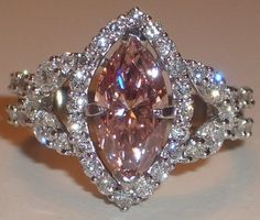 Pink diamond marquise with halo. A pink diamond version of Cory's grandmother's ring, just without the panthers. Vintage Engagement Rings, Diamond Engagement Rings, Halo Engagement, Beautiful Rings, Diamond Jewelry, Diamond Rings, Solitaire Rings, Jewelery, Jewellery Box