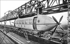 This mass-transit railway was a propeller-driven train suspended beneath a monorail in Glasgow, Scotland. The test track for the Bennie Railplane was built . Locomotive, Old Pictures, Old Photos, Vintage Photos, Hover Car, Ground Transportation, Rail Transport, Old Trains, Dieselpunk
