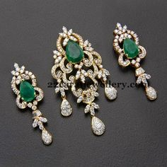 18 carat gold pendant and earrings studded with diamonds and large faceted cut cabochon green pear shaped emeralds