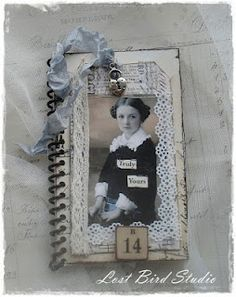 mini journal, embellished with old lace, photos and trinkets.  Love it.