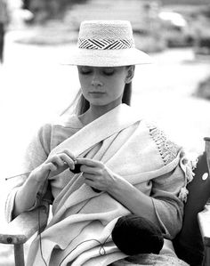 Audrey Hepburn takes a knitting break during the filming of The Unforgiven She also knitted her co-star and onscreen mother, Lillian Gish a poncho.