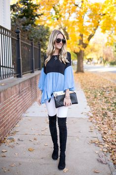 Love this way of wearing white in the winter! With blue and over the knee boots