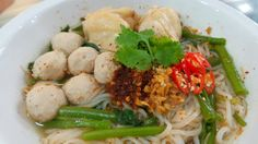 Rice noodles soup with meatballs and chicken.