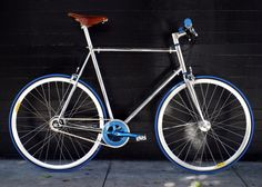 Mission Bicycle Co. silver bike style with white and blue wheels. See more stylish women on bikes at melisinestudio.com and @melisinestudio on instagram.