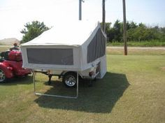 The 2003 Aspen Motorcycle Camper Trailer for Sale is a tent camping trailer in…