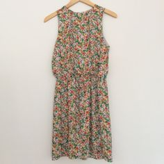 """H&M Tropical Floral Dress Elegant chiffon dress in a gorgeous tropical floral print. Keyhole back with single button closure. Easy to dress up or down for day or night! Excellent used condition with no stains, holes, tears, or visible signs of wear. 100% polyester, fully lined.  Marked size 6  FLAT MEASUREMENTS: 17.5"""" bust 12.5"""" elasticized waist 35"""" length  Reasonable offers considered. Thanks for looking! H&M Dresses"""
