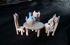 Exclusive miniature creature reading book with fairy furniture by AnnaLitinsky. OOaK