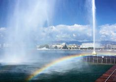 """Jet d'Eau (""""Jet of Water"""") iconic symbol of strength and elegance of Geneva. May catch a rainbow if you're there on a sunny day. Double rainbow actually the second one is a bit smaller fainter on the top of this one and not easy to capture.  They say the nozzle shoots a mixture of water and air at the velocity of 200km/h to the height of 140m. When I approached the huge jet astounded by its grandeur I pulled out my phone and thought of checking the information given (for fun). Let's say…"""