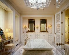 lovely bath design, with a marble vessel tub centered in the room...