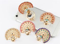 Peacock iPhone Ring Stand W/ Rhinestone Ring Stand - Samsung Ring Holder -iPhone Ring Case - iPhone Ring Case, Finger Ring - Phone Holder by PetrichorCases on Etsy Ring Stand, Ring Finger, Phone Holder, New Product, Phone Accessories, Peacock, Crochet Earrings, Smartphone, Iphone Cases