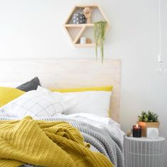 Scandinavian bedroom mustard and grey scandi style with a plywood headboard via @thedesignminimalist