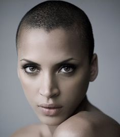 French Model/actress Noemie Lenoir. She looks beautiful with a shaved head