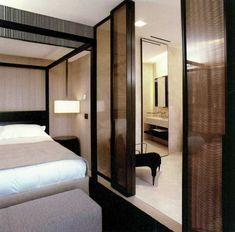 Bulgari hotels - Screen Design with mesh inside glass panels - inside bronze frame