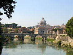 St. Peter's Basilica from the River Tiber. Vatican City, Rome, Italy. Built in 1626.