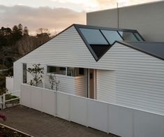 Faced with a difficult alternation, architect Henri Sayes used a clear and uncompromising vision to create this wonderful little apartment. Old Garage, Best Architects, Built In Bench, Black Doors, Outdoor Living Areas, House And Home Magazine, Little Houses, Amazing Architecture, Victorian Homes